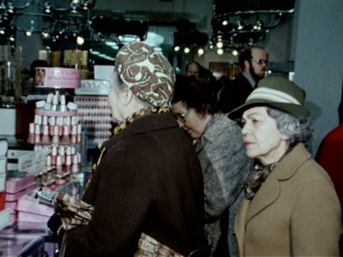 shop assistants help customers in the beauty section of a department store. - department store stock videos & royalty-free footage