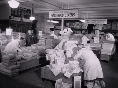 shop assistants sort out sale items in the bed linen section of a department store. - department store stock videos & royalty-free footage