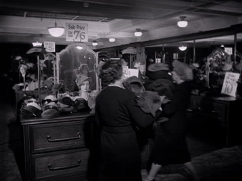 shop assistants sort out sale items in the millinery section of a department store. - department store stock videos & royalty-free footage