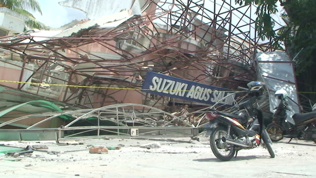 shop destroyed by earthquake in downtown padang, sumatra / audio - indonesia earthquake stock videos & royalty-free footage