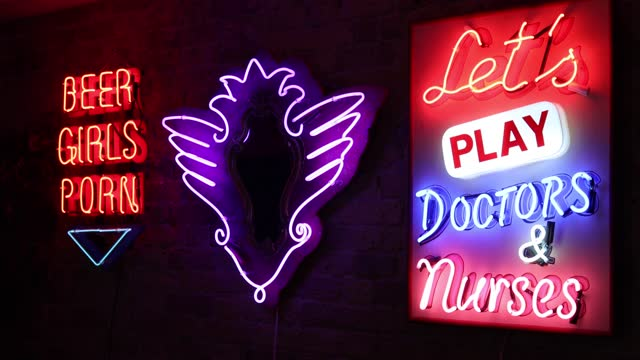 """shop displays neon signs during the electric city, """"gods own junkyard's"""" exhibition photo call at leadenhall market on may 25, 2021 in london,... - neon stock videos & royalty-free footage"""