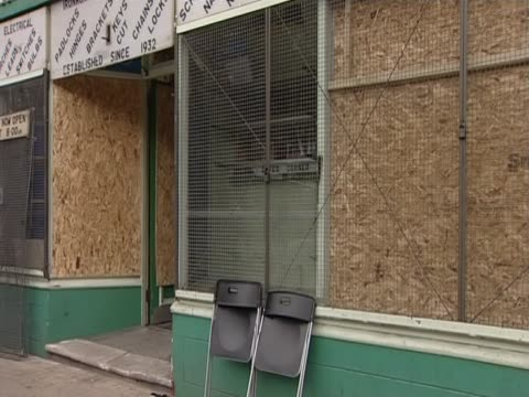 shop fronts boarded up after rioting across various uk cities, august, 2011 - window display stock videos & royalty-free footage