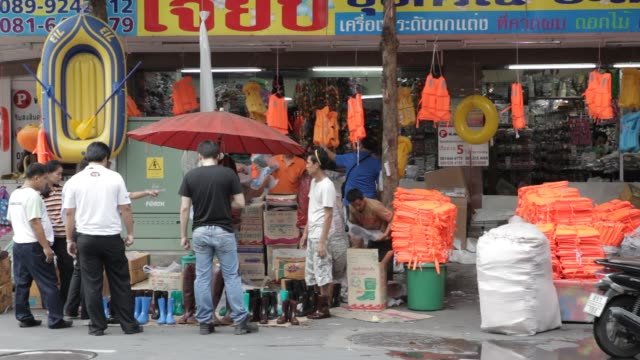 a shop in bangkok's chinatown diversifies into selling lifejackets boats and wellington boots as residents in central bangkok prepare for expected... - bronek kaminski stock videos & royalty-free footage