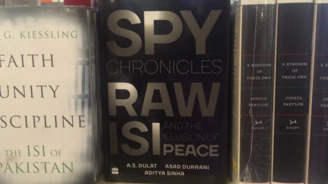 vídeos de stock, filmes e b-roll de shop in islamabad showcases a nearly unthinkable book: spy chronicles a secret collaboration by former intelligence chiefs of india and pakistan that... - ex