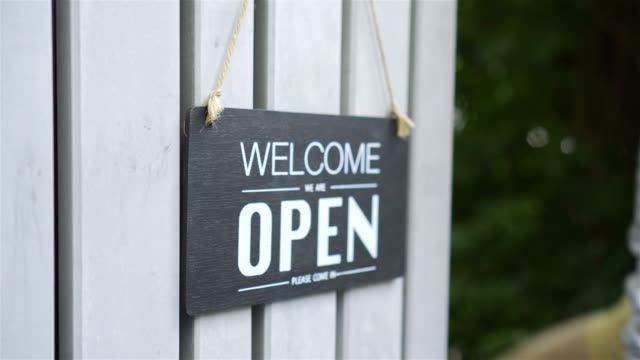 shop opening sign. - shop sign stock videos & royalty-free footage