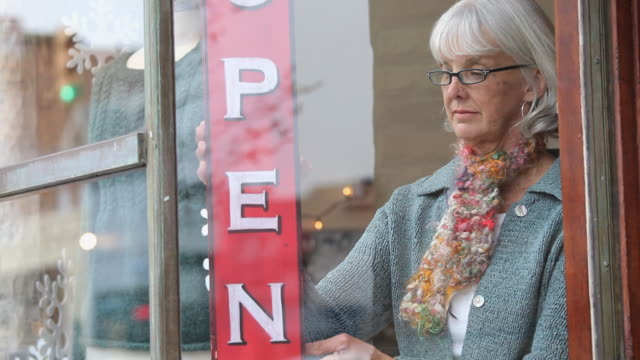 ms tu shop owner placing open sign in window of knitting store / richmond, virginia, usa - window display stock videos & royalty-free footage