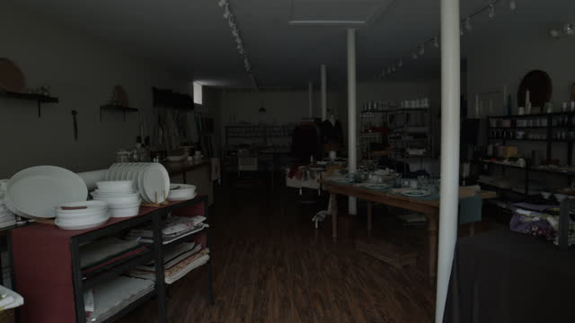 shop owner turns off lights at end of day in retail store - turning stock videos & royalty-free footage