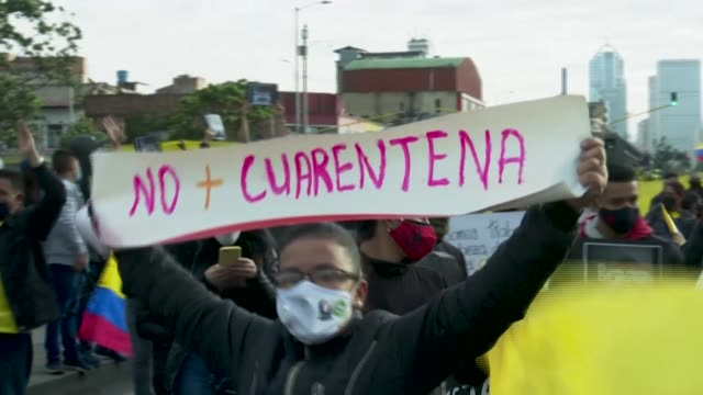 shop owners and street vendors protest in bogota against new lockdown measures imposed by the capital's mayor claudia lopez, and ask for the... - latin america stock videos & royalty-free footage