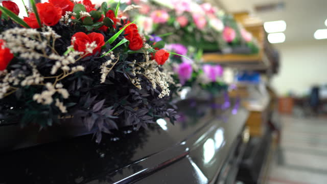 shop selling coffins and funeral wreaths - funeral stock videos & royalty-free footage