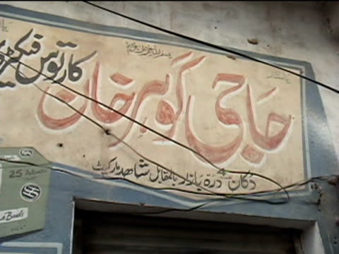 shop sign of bullet making workshop darrah district in tribal zone at afghan border federally administered tribal areas pakistan audio - ladenschild stock-videos und b-roll-filmmaterial