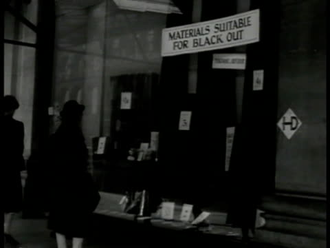 shop w/ sign 'materials suitable for black out'. man smoking cigarette in front of clothing store window. int tailor shop w/ man in suit being... - 1941 stock videos & royalty-free footage