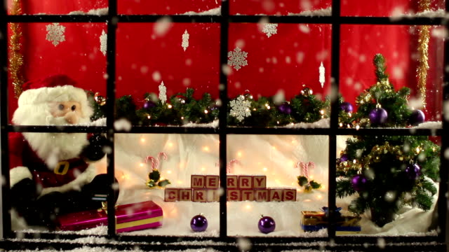 Shop window display at Christmas with snow