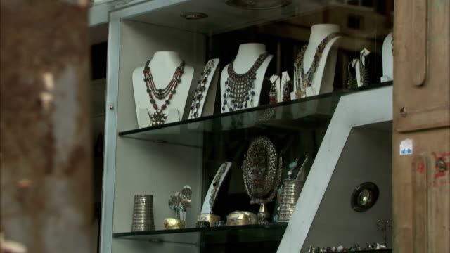 a shop window displays jewellery. - jewellery stock videos & royalty-free footage