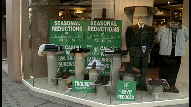 "shop window of ""principles"" mens clothes & sign london seasonal reductions, sign "" #1/2 million bankrupt oxford stock to clear"", shoppers looking in... - 0 1 months stock videos & royalty-free footage"