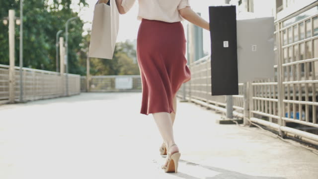 shopaholic woman happy shopping jumping with shopping bag - shopaholic stock videos & royalty-free footage
