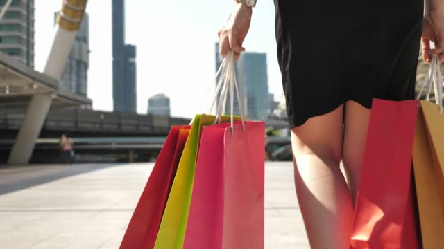 shopaholics walking with shopping bags after shopping day - shopping bag stock videos & royalty-free footage