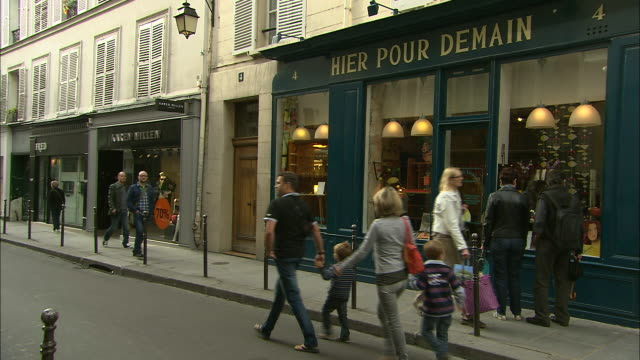 shopfronts on a small street in the marais, paris, france - pedestrian zone stock videos & royalty-free footage