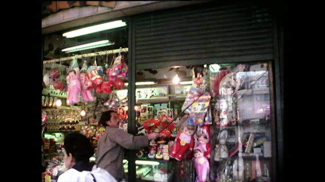 ws shopkeeper opens metal shop shutters on hiroshima store; 1975 - shutter stock videos & royalty-free footage