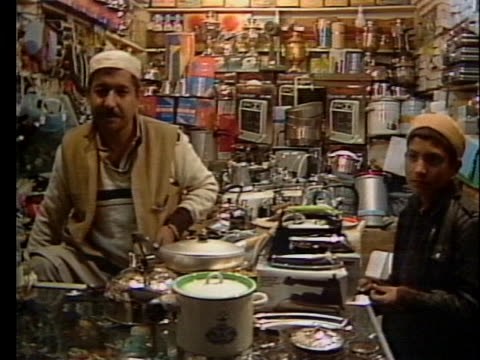 a shopkeeper watches customers in a pakistani market - crime or recreational drug or prison or legal trial stock videos & royalty-free footage