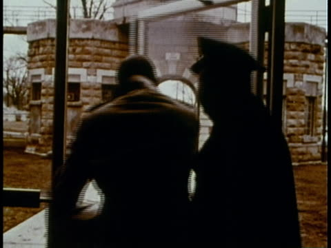 1969 montage shoplifter being released from prison and greeted with a hug by woman / united states - loslassen aktivitäten und sport stock-videos und b-roll-filmmaterial