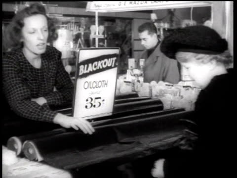 shopper buying blackout window shades from a clerk at woolworth's department store / new york city, new york, united states - grande magazzino video stock e b–roll