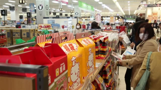 shopper looks at fukubukuro lucky bags at the aeon lake town shopping mall, operated by aeon retail co., a unit of aeon co., on the first day of the... - 正月点の映像素材/bロール