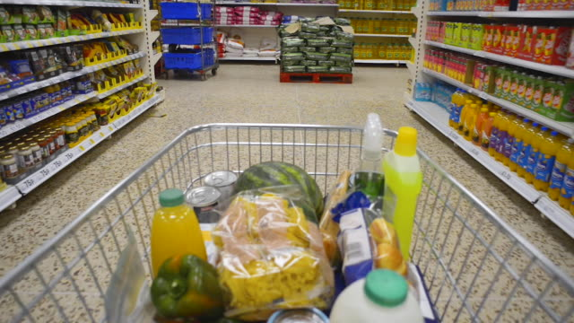 shopper point of view in supermarket aisle - shopping trolley stock videos & royalty-free footage
