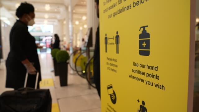 shopper walks past safety signs in selfridges on oxford street on june 15, 2020 in london, england the british government have relaxed coronavirus... - customer stock videos & royalty-free footage