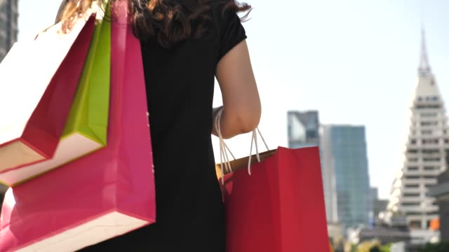 Shopper with shopping bags in City