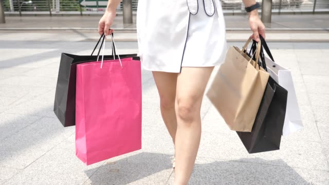 shopper with shopping bags - shopping bag stock videos & royalty-free footage