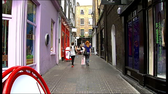 Shoppers along on and around Carnaby Street Reporter to camera