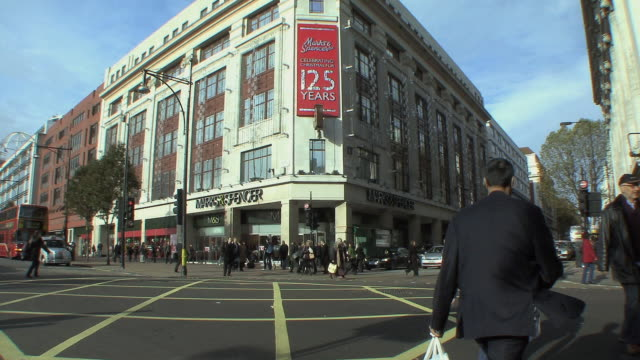 ws shoppers and street traffic in front of marks and spencer department store / london, uk.   - land vehicle stock videos & royalty-free footage