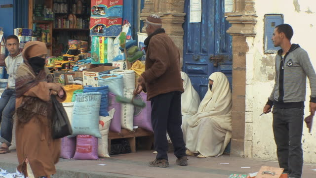 ms selective focus shoppers and vendors in medina, essaouira, morocco - old town stock videos & royalty-free footage