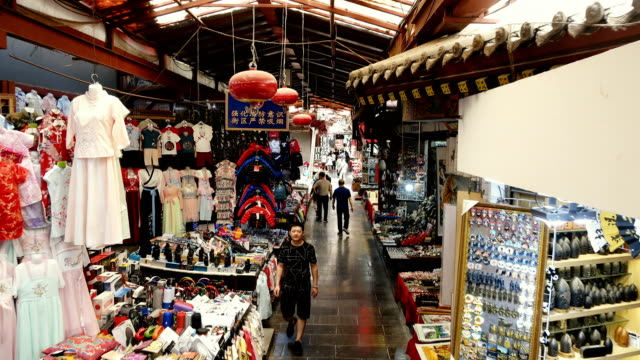 shoppers at a historical market nearby huis street,xi'an,china. - sign stock videos & royalty-free footage