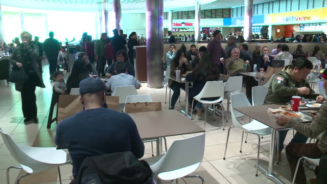 wgn shoppers at food court mall on black fridaynear chicago on nov 24 2017 - food court stock videos and b-roll footage