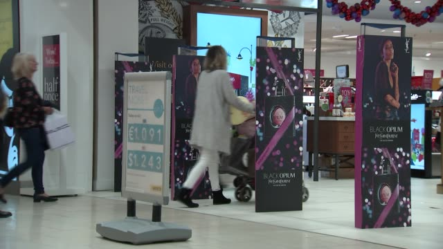 stockvideo's en b-roll-footage met shoppers at intu lakeside shopping centre at christmas; england: essex: thurrock: lakeside shopping centre: int 'debenhams' shop in shopping centre.... - shopping centre