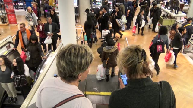 Shoppers at the Herald Square Macy's Department Store on December 23 a day before Christmas Eve / Christmas shopping follows Black Friday in the...