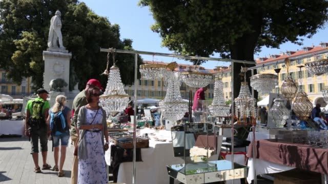 shoppers browse antiques and knick knacks in an open air market in the old town in nice france on thursday may 14 2015 - antique stock videos & royalty-free footage
