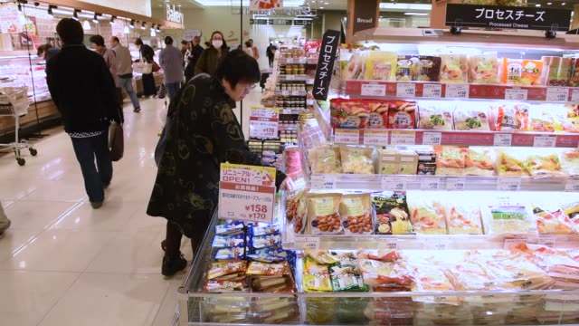 Shoppers browse food items at a supermarket inside the Ito Yokado Co Ario shopping center owned by Seven i Holdings Co during its reopening in Tokyo...