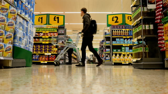 shoppers buy groceries and goods inside rochdale's morrisons supermarket on january 23 2017 in rochdale england wm morrison supermarkets plc has over... - rochdale england stock videos & royalty-free footage