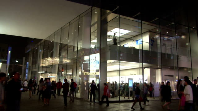 shoppers buy iphones and ipads at the first apple store to open in china at sanlitun village in beijing / when the store failed to open in january... - stephenie hollyman stock videos & royalty-free footage