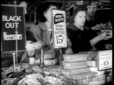 ms shoppers buying blackout accessories / new york city new york united states - anno 1942 video stock e b–roll
