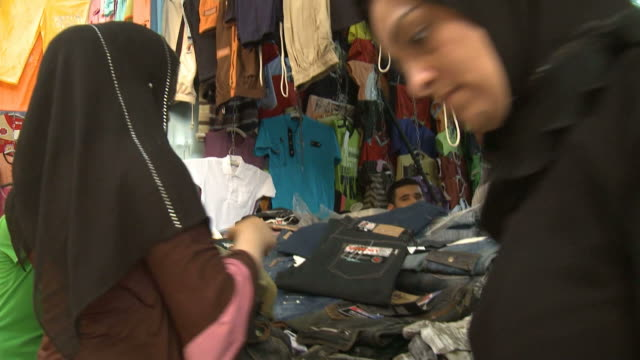 MS Shoppers buying clothes at a market in Yarmouk / Baghdad Iraq