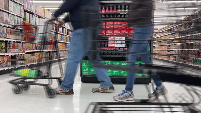 shoppers choosing coca-cola and employees arranging coca-cola shelves in grocery store. coca cola is scheduled to announce their fourth-quarter 2020... - orem utah stock videos & royalty-free footage