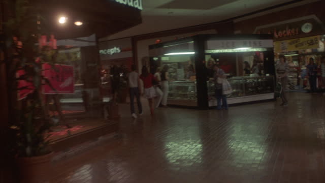 shoppers clear a path in a shopping mall. - consumerism stock videos and b-roll footage