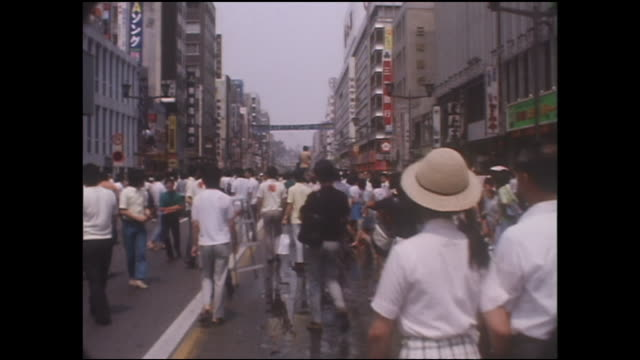 shoppers crowd a ginza street on the first day of the pedestrian paradise. - showa period stock videos & royalty-free footage
