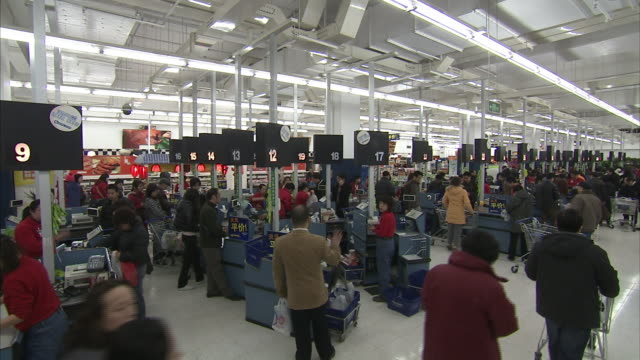 Shoppers crowd a Walmart in China.