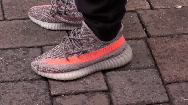 shoppers desperate to get their hands on new kanye west shoes have set up camp outside a fashion retailer - days before they are released. fans of... - adidas stock videos & royalty-free footage