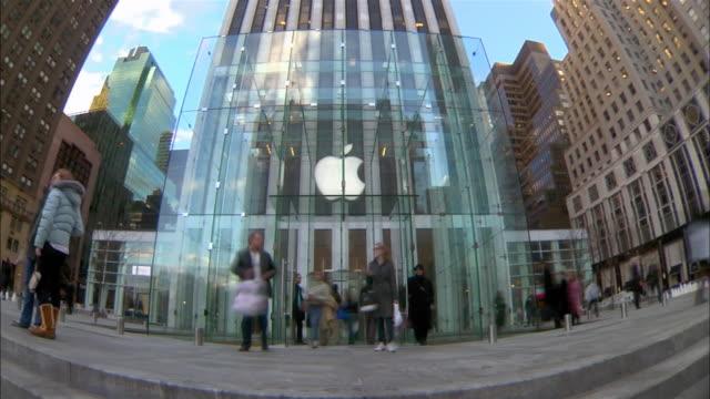 shoppers enter and exit an apple store on 5th avenue in manhattan. - apple store stock videos & royalty-free footage