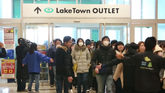 shoppers enter the aeon lake town shopping mall operated by aeon retail co a unit of aeon co on the first day of the new year sales in koshigaya... - point of sale stock videos and b-roll footage